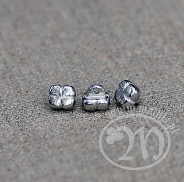 Tin alloy clover button