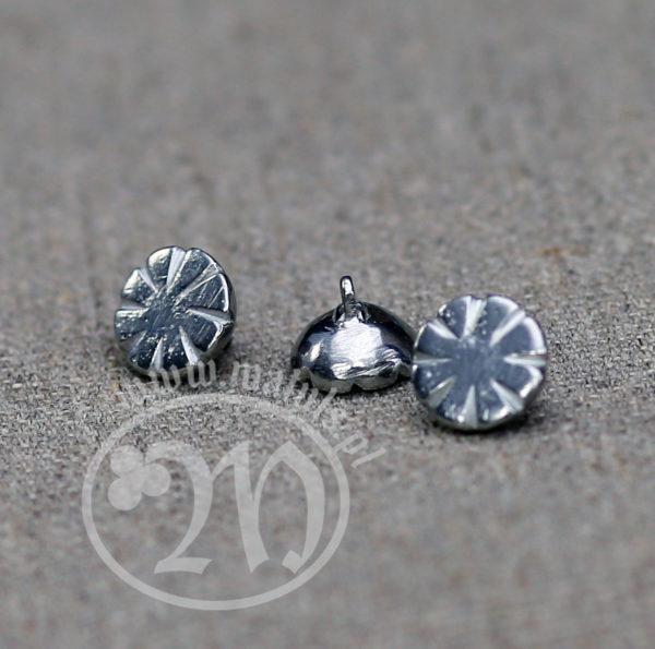 Tin alloy rosette button.