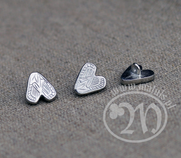 Tin alloy heart button.