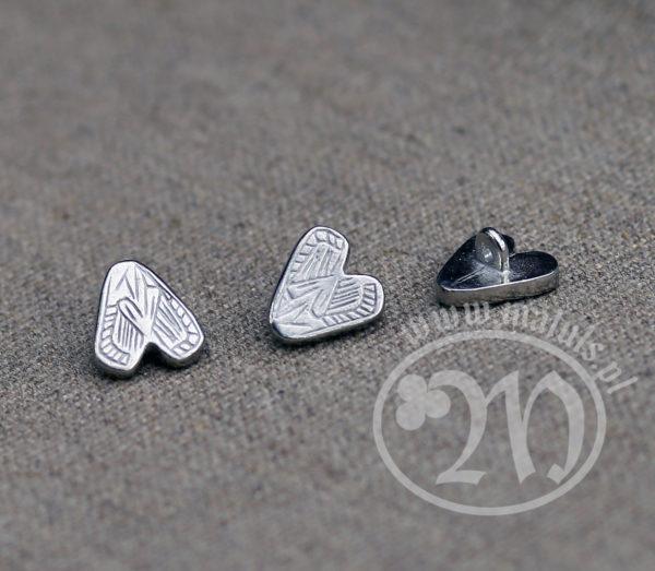 Tin alloy heart button.